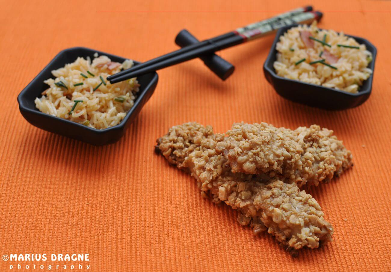Peste cu crusta de alune si orez prajit